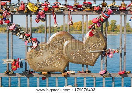 Irkutsk, Russia, 20 September 2016. Two hearts pierced by an arrow of love that says