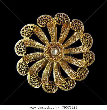 Vintage filigree silver gilded brooch Flower isolated on blsck background