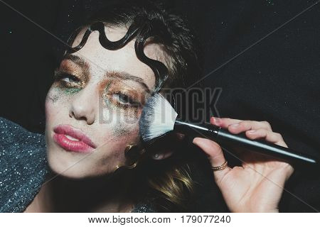 Pretty Fashion Girl Putting Holiday Glitter Makeup