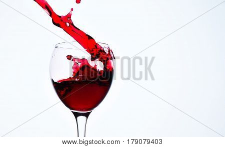 One glass with red wine and sprays