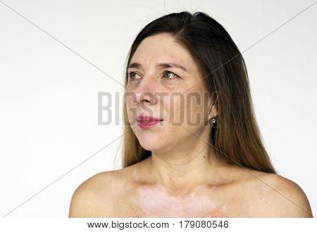 Woman bare chest naked smiling studio portrait