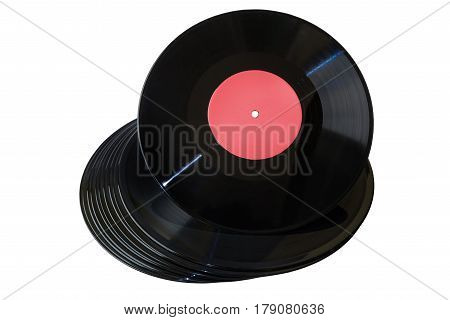 Vinyl disc with red label on vinyl stack on white background