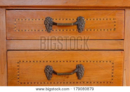 particular of an ancient furniture with drawers with inlay