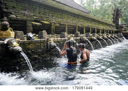 Travellers Praying And Take A Bath At Holy Spring Water