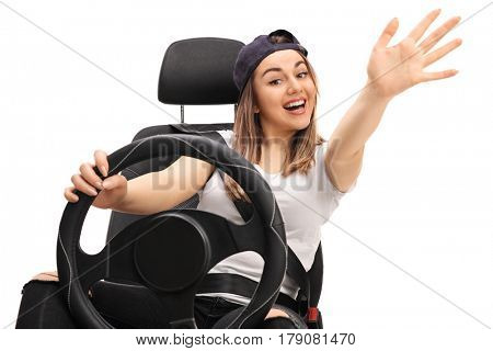 Joyful teen driver waving at the camera isolated on white background