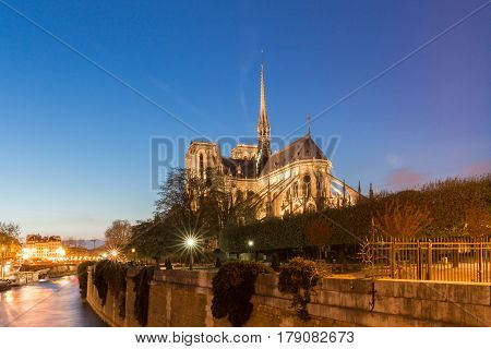 The Notre Dame cathedral in evening Paris France.