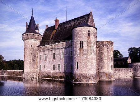 The chateau of Sully-sur-Loire in the evening, France. This castle is located in the Loire Valley, dates from the 14th century and is a prime example of medieval fortress.
