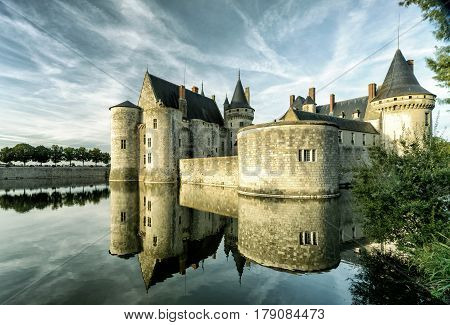 The chateau of Sully-sur-Loire in the evening, France. This castle is located in the Loire Valley dates from the 14th century and is a prime example of medieval fortress.