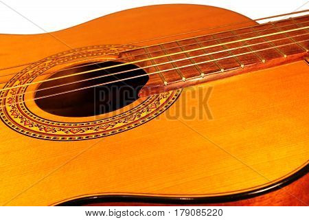 Classic acoustic guitar at weird and unusual perspective closeup. Six strings free frets sound hole and soundboard. Musical instruments shop or learning school concept