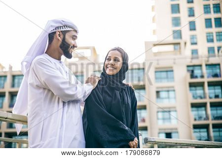Arabic couple with traditional clothes dating outdoors