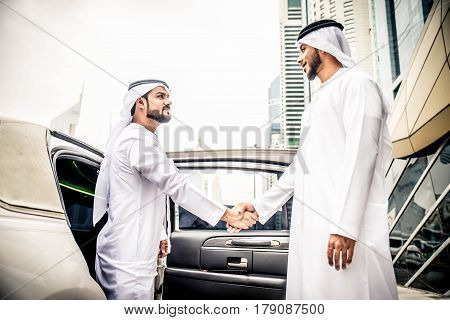 Arabic businessmen in Dubai handshaking after a business meeting