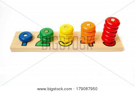 Wooden colored blocks, rings. Game for learning account.Wooden colored blocks, rings. Game for learning account.Shallow DOF