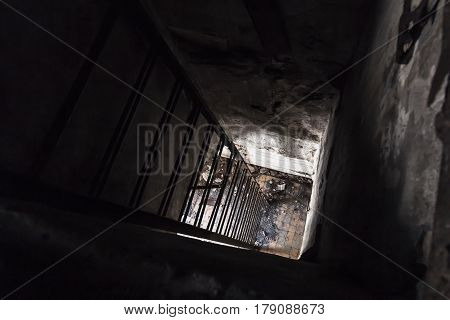 Rusted Metal Ladder Going Down From Dark Room