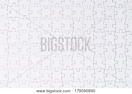 A white jigsaw puzzle close-up. Copy Space Isolated on White Background