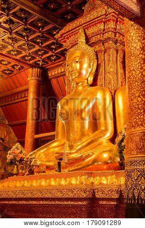 Golden Buddha Statue At Temple Nan, Thailand