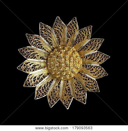 Vintage filigree gilded silver brooch Sunflower isolated on black background