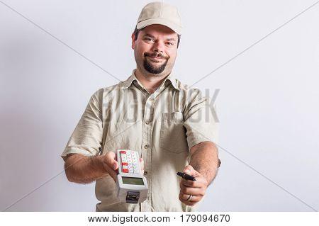 Studio shot of uniformed messenger on white background