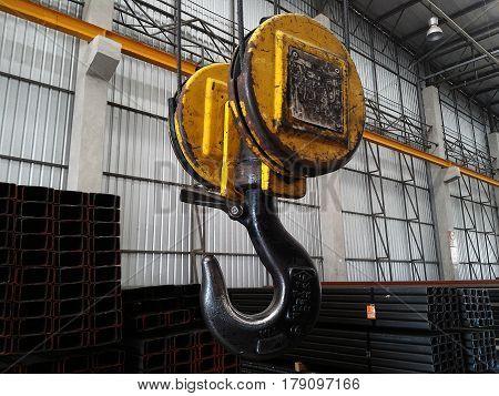 big yellow hook of crane after workhard
