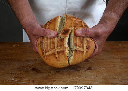 ZAGREB, CROATIA - SEPTEMBER 21: Breaking of a fresh loaf of Eucharistic bread in Zagreb, Croatia on September 21, 2016.