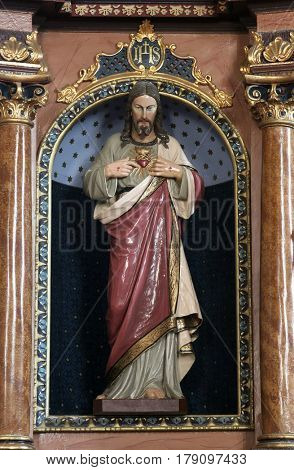 MARTINSKA VES, CROATIA - JUNE 03: Sacred heart of Jesus statue on the altar in Parish Church of Saint Martin in Martinska Ves, Croatia on June 03, 2011.