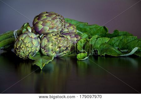 Ripe Organic Artichokes on a wooden table