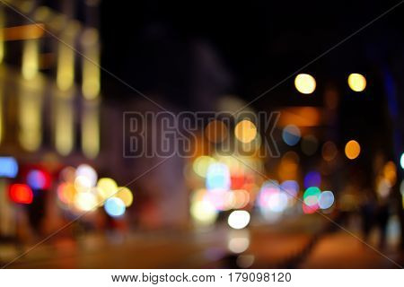 City lights night view, blur bokeh photo. Blurred background with lights of the city at night. Bokeh basic background for design