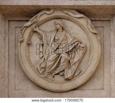 ROME, ITALY - SEPTEMBER 01: Medallion Justice on the Palazzo Montecitorio, seat of the Italian Chamber of Deputies in Rome, Italy on September 01, 2016.