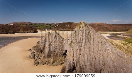 Dramatic Three Cliffs Bay on the Gower peninsula, Swansea, South Wales.
