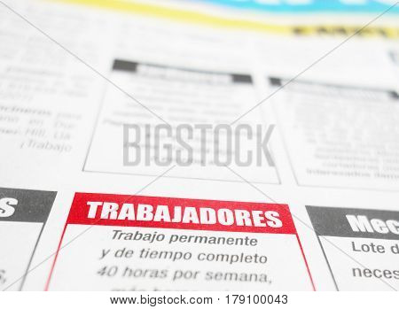 Spanish language newspaper employment classified section with Trabajadores (Jobs) in red