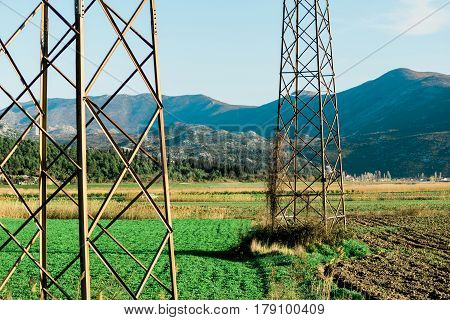 Part of electric columns next to farmland