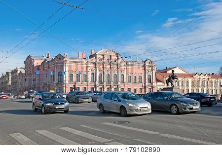 SAINT-PETERSBURG, RUSSIA, MARCH 29, 2017: City transport on the Nevsky Avenue near The Anichkov Bridge with The Horse Tamers by Peter Klodt. On the background is Beloselsky-Belozersky Palace