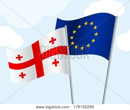 flag of Georgia and the European Union develop in the wind on a blue sky background with clouds. Concept cooperation, friendship, union, visa-free regime. Vector illustration. 3D style.