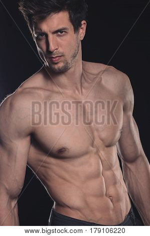 Handsome Shirtless Muscular Young Man On Dark Background