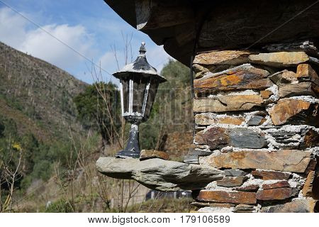 Old style street lamp placed on the shale wall