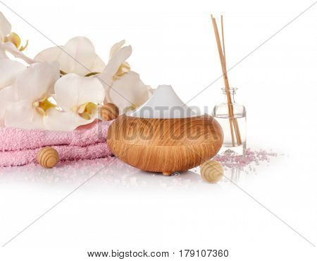 Aroma oil diffuser and spa set on white background