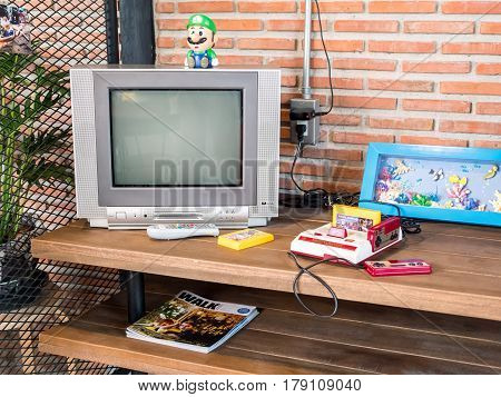 Chonburi Thailand - March 25 2017: Nintendo family computer the video game console for home or portable gaming.