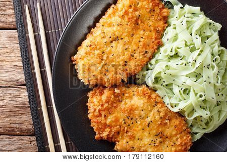 Chicken Cutlet In Breadcrumbs And Noodles With Green Tea Macha On The Table. Horizontal Top View