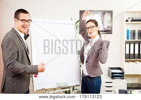 succesful business team standing next to an empty flipchart