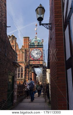 Chester England UK - March 25 2017: The ornate wrought iron Eastgate Clock over Chester's east gate a prominent city landmark built to celebrate the diamond jubilee of Queen Victoria in 1897