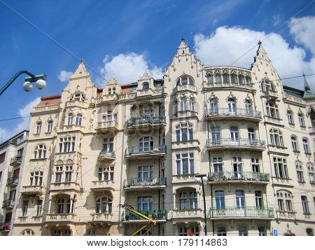 Facade of traditional european apartment building in Prague old town, Czech Republic. Downtown urban old city street, Italy. Popular tourist destination of Europe.