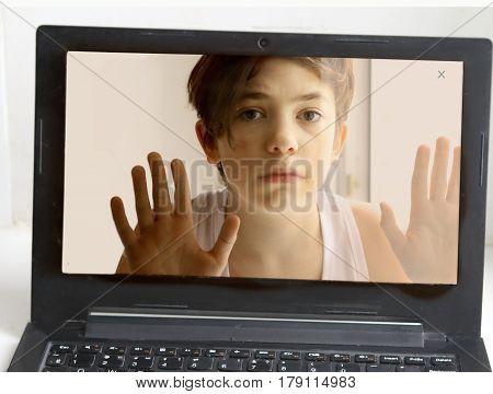 Teenager Boy Behind Computer Monitor Screen