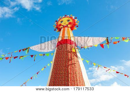 SAMARA RUSSIA - FEBRUARY 26 2017: Shrovetide in Russia. Big doll for the burning on the blue sky background