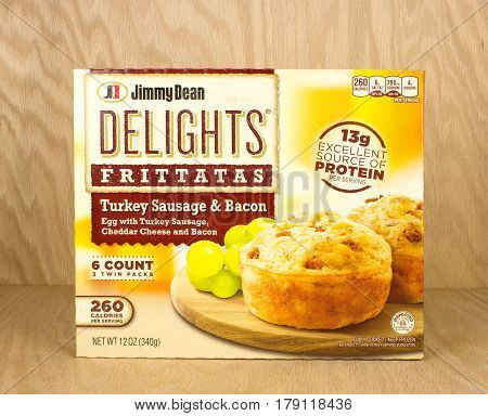 RIVER FALLS,WISCONSIN-MARCH 17,2017: A box of Jimmy Dean brand turkey sausage and bacon frittatas with a wood background.