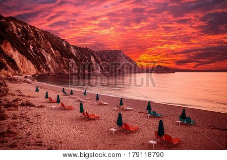Sunset over Petani beach, Kefalonia island, Greece. View of Petani bay and beautiful beach, Kefalonia island, Greece.