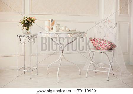 White Retro Iron Furniture With Coffee Set On The Table