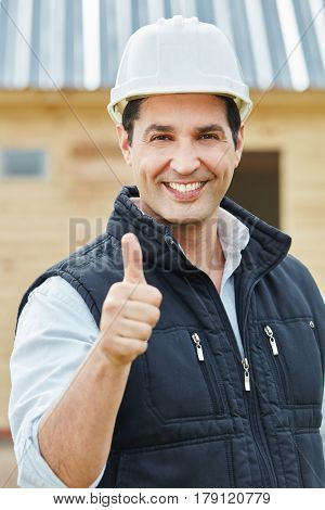 Successful craftsman or foreman holding thumbs up