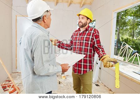 Construction site with craftsman and artisan planning and solving problems