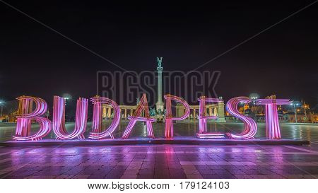 Budapest Hungary - The beautiful Hero's Square Hosok tere or or Millennium Monument by night. This is a major attraction of Budapest with 36 m high Corinthian column in center.