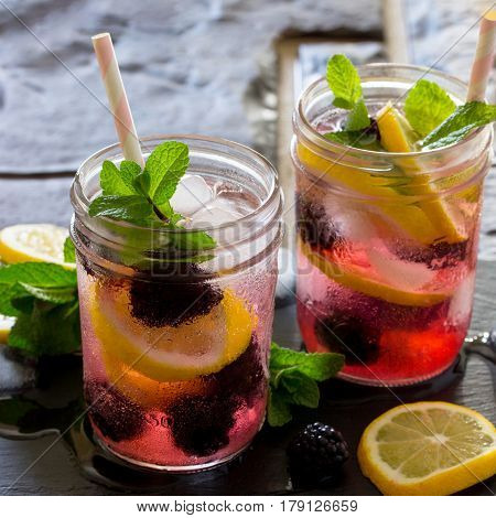 Refreshing Summer Drink With Blackberries, Lemon And Mint On A Stone Background. The Concept Of Eati