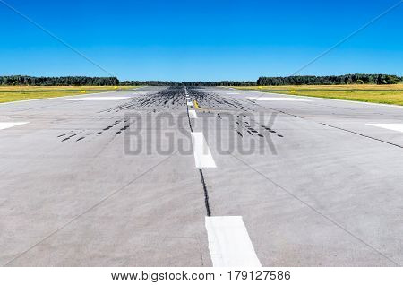 Runway at the airport and the blue sky conceptual aviation.